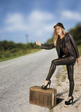 Female hitch hiker. Royalty Free Stock Images