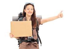 Female hitchhiker holding a blank banner Stock Image