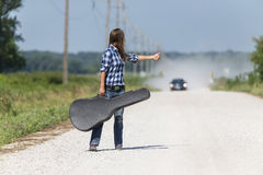 A Female Hitchhikes On A Dirt Road Stock Images