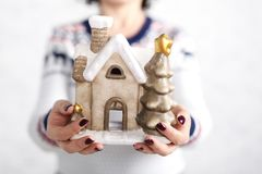 Female hold chistmas decoration and give it Royalty Free Stock Photography