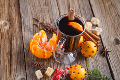 Female hold glass of hot mulled wine Royalty Free Stock Photos