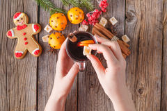 Female hold glass of hot mulled wine Royalty Free Stock Images