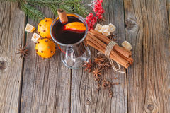 Female hold glass of hot mulled wine Stock Image