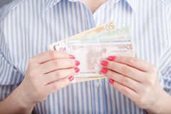Female hold money in hands Royalty Free Stock Images