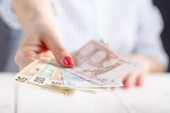Female hold money in hands Stock Photos