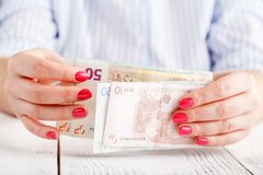 Female hold money in hands Stock Image