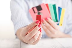 Female hold old floppy disk and modern flash drive Royalty Free Stock Photography