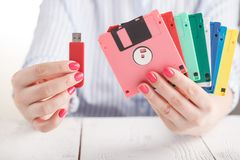 Female hold old floppy disk and modern flash drive Stock Photo