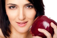 Female holding an apple Royalty Free Stock Photography