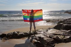 Female holding an Australian flag in rainbow colours. On November 15 Australia voted yes to Marriage Equality.  A woman holding an Australian flag in rainbow Stock Photos