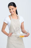 Female holding baking mixture in bowl Stock Photo
