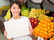 Female holding a banner at the supermarket Stock Photography