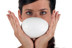 Female holding a bar of soap Royalty Free Stock Photo