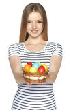 Female holding basket with Easter eggs Royalty Free Stock Photography