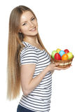 Female holding basket with Easter eggs Stock Photos