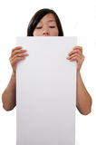 Female holding blank sign. Female holding blank white sign on white background Stock Photo