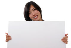 Female holding blank sign. Female holding blank white sign on white background Royalty Free Stock Photography