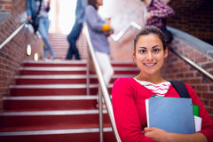 Female Holding Books With Students On Stairs In College Royalty Free Stock Photography