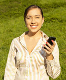 Female holding a cell phone Royalty Free Stock Photos