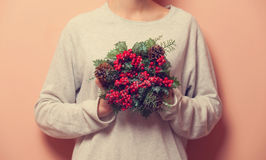 Female holding a christmas bouquet Royalty Free Stock Photography