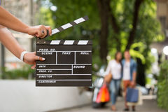 Female  holding clapper board Stock Photo