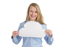 Female holding a cloud. Blonde female holding a cloud and smiling Stock Photo