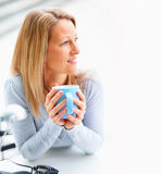 Female holding a coffee cup Royalty Free Stock Image