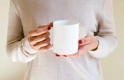 Female holding a coffee mug, styled stock mockup photography Stock Images