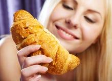 Female holding croissant Royalty Free Stock Photos