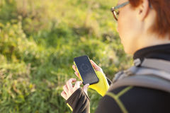 Female holding digital compass in the nature Stock Photo