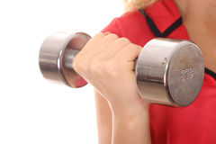 Female holding dumbbell weight. Shot of a female holding dumbbell weight up close Stock Photo