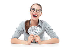 Female holding a fan of money Stock Photography