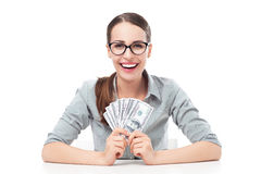 Female holding a fan of money Stock Image