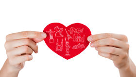 Female holding heart with her arms and famous touristic symbols Royalty Free Stock Photos