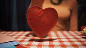 Female holding heart pendulum in hands, weak broken love symbol stock video footage
