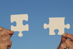 Female holding jigsaw pieces Royalty Free Stock Photography