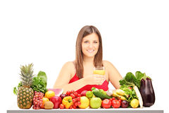 Female holding a juice and posing Royalty Free Stock Photos