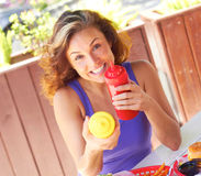 Female Holding Ketchup And Mustard Bottles Royalty Free Stock Image