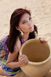 Female holding a large clay pot Stock Photos