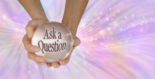 Go on - Ask me a Question. A female holding a large clear crystal ball with ASK A QUESTION within against a feminine pink swishing sparkling background with copy stock photo