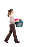 Female holding a laundry basket Royalty Free Stock Images