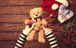 Female holding a little teddy bear Stock Photo