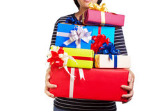 Female holding a lot of Christmas/birthday/anniversaries gifts. Asian female holding a lot of Christmas/birthday/anniversaries gifts in her hands.The most stock photo