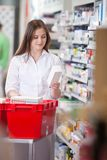 Female Holding Medicine Box stock image