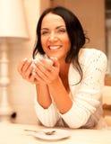 Female holding a mug of coffee Royalty Free Stock Image