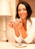 Female holding a mug of coffee Royalty Free Stock Photos