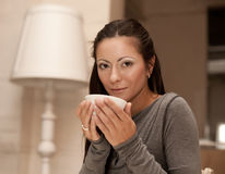 Female holding a mug of coffee Royalty Free Stock Photo