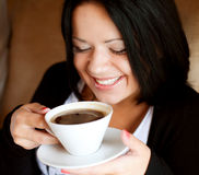 Female holding a mug of coffee Stock Image