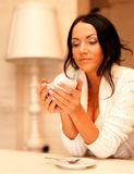 female holding a mug of coffee Stock Images