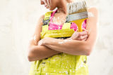 Female holding paint brush Royalty Free Stock Images